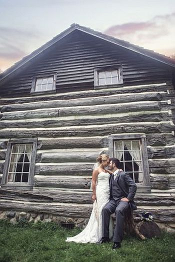 bride and groom by moon log cabin image