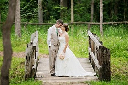 bride and groom on bridge image