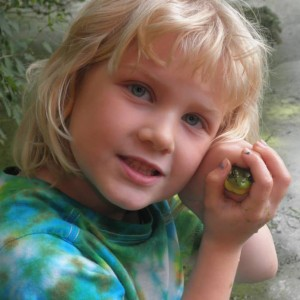 child with frog image